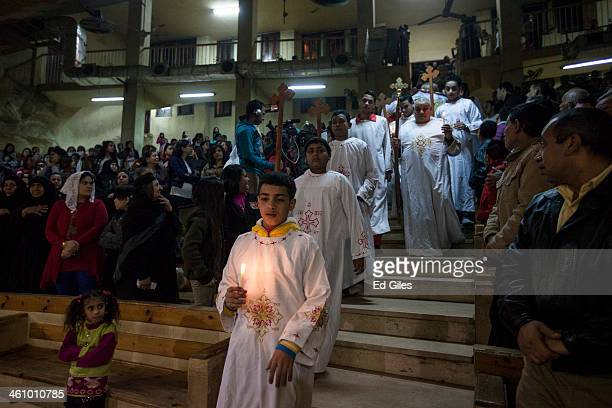 Egyptian Coptic Christians take part in a processsion during a Christmas Eve mass in a chapel at the St Saman Monastery in the Manshiet Nasser...