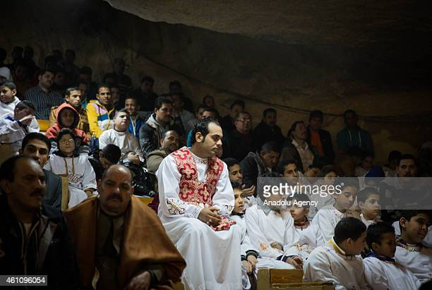 Egyptian Coptic Orthodox Christians attend a Christmas Eve mass at the Church of Saint Samaan on the Moqattam hills in Cairo Egypt on January 6 2015