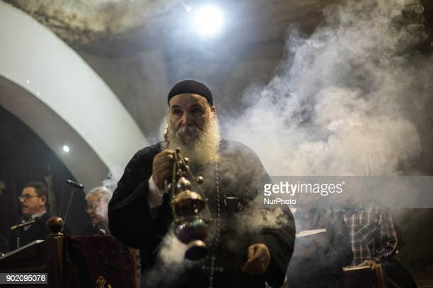Egyptian Coptic Orthodox Christians attend the Christmas Eve mass at the Nativity of Christ Cathedral in Cairo on January 6 2018 Coptic Orthodox...