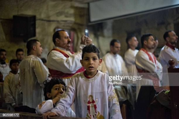 Egyptian Coptic Orthodox Christians attend the Christmas Eve mass at the Nativity of Christ Cathedral in Cairo, on January 6, 2018. Coptic Orthodox...