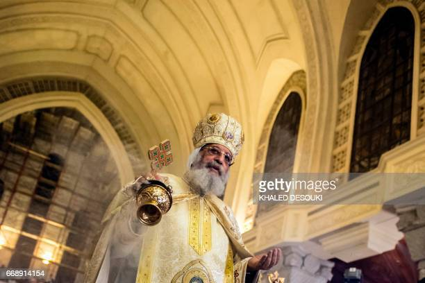 Egyptian Coptic Pope Tawadros II leads the Easter mass at the Saint Mark's Coptic Cathedral in Cairo's alAbbassiya district on April 15 2017 / AFP...