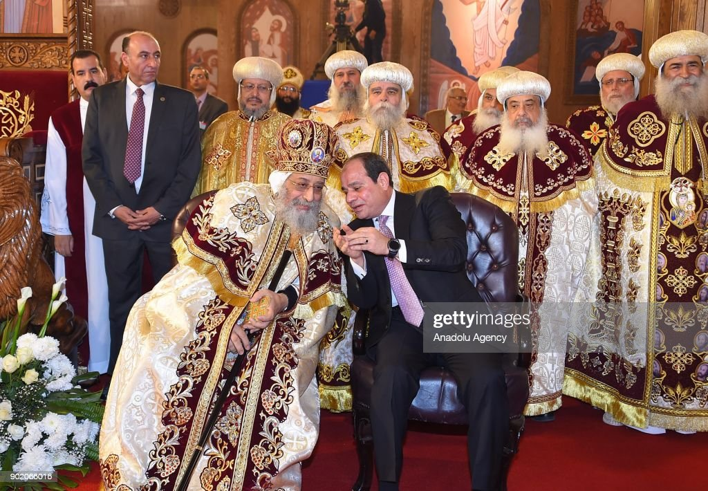 Egyptian Coptic Pope Tawadros II (L), Pope of Alexandria and Patriarch of Saint Marc Episcopate, receives Egyptian President Abdel Fattah al-Sisi (R), during the opening ceremony of the new Coptic Cathedral in Cairo, Egypt on January 6, 2018.