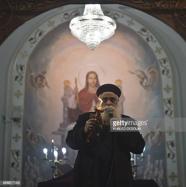Egyptian Coptic priest Dawood Ibrahem head of the Virgin Mary Coptic Christian church in Cairo's working class neighborhood of AlWarrak leads the New...