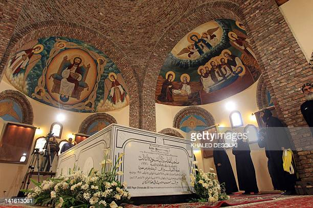 Egyptian coptic priests stand next to the tomb where Pope Shenuda III the spiritual leader of the Middle East's largest Christian minority will be...