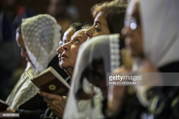 Egyptian Coptic women attend a mass led by Egypt's Coptic Pope Tawadros II to honor the memory of the Egyptian Coptic Christians murdered by Islamic...