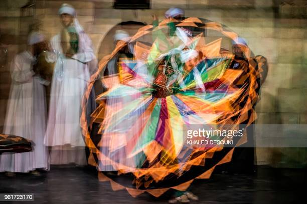 TOPSHOT Egyptian dancers perform the Tanoura during the holy fasting month of Ramadan at elGhuri culture Palace in Cairo on May 22 2018