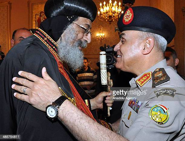 Egyptian Defence Minister Sedki Sobhi visits Coptic Pope Tawadros II in order to celebrate Easter at St Mark's Cathedral in Cairo Egypt on April 20...