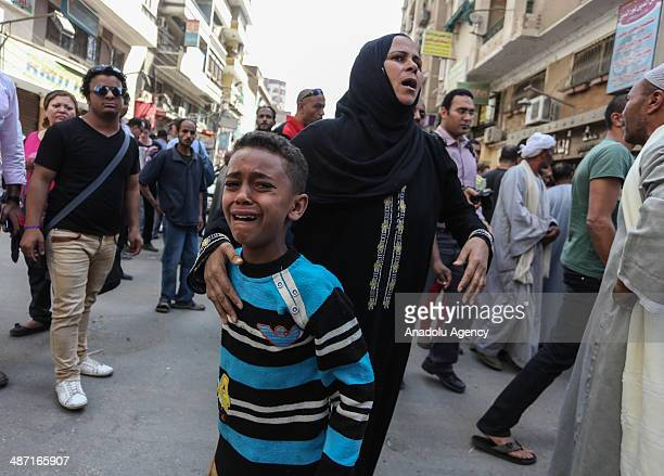 Egyptian defendants' relatives mourn after Egypt court refers 638 Morsi backers, including the Muslim Brotherhood leader Mohammed Badie to mufti for...