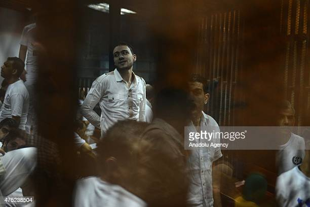 Egyptian defendants sit behind bars during their retrial over a 2012 stadium riot in the canal city of Port Said that left 74 people dead on May 30,...