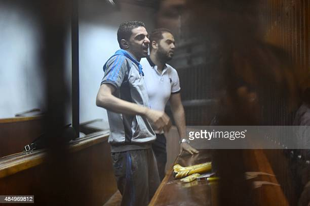 Egyptian defendants wait behind bars for the verdict in their retrial over a 2012 stadium riot in the canal city of Port Said on August 23 2015 at...