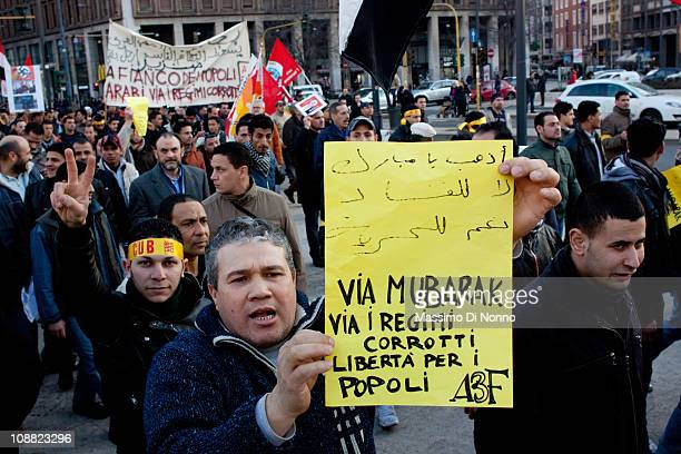 Egyptian demonstrator shows a placard reading 'Mubarak go away' during the protest against Egypt's President Hosni Mubarak on February 4 2011 in...