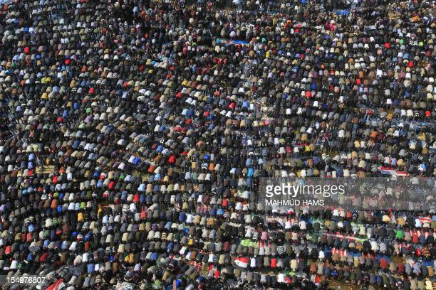 Egyptian demonstrators perform the Friday noon prayer in Cairo's Tahrir square on November 25 as the head of the country's ruling military council...