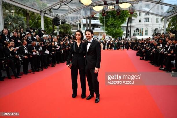 Egyptian director AB Shawky and Dina Emam pose as they arrive on May 9 2018 for the screening of the film 'Yomeddine' at the 71st edition of the...