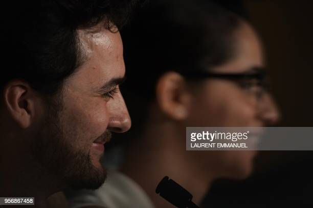 Egyptian director AB Shawky and producer Dina Emam attend a press conference for the film 'Yomeddine' on May 10 2018 at the 71st edition of the...
