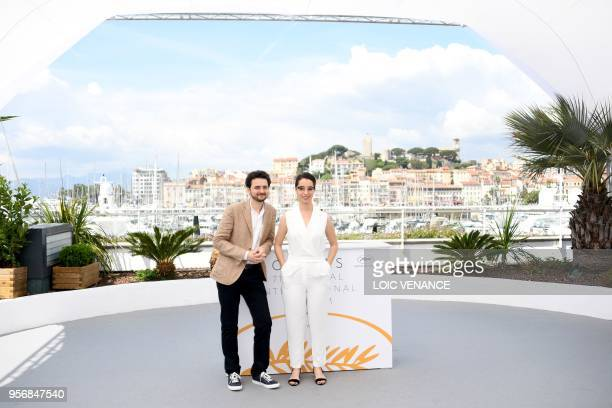 Egyptian director AB Shawky and producer Dina Emam pose on May 10 2018 during a photocall for the film 'Yomeddine' at the 71st edition of the Cannes...