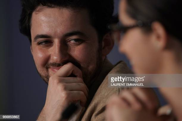 Egyptian director AB Shawky listens to producer Dina Emam on May 10 2018 during a press conference for the film 'Yomeddine' at the 71st edition of...