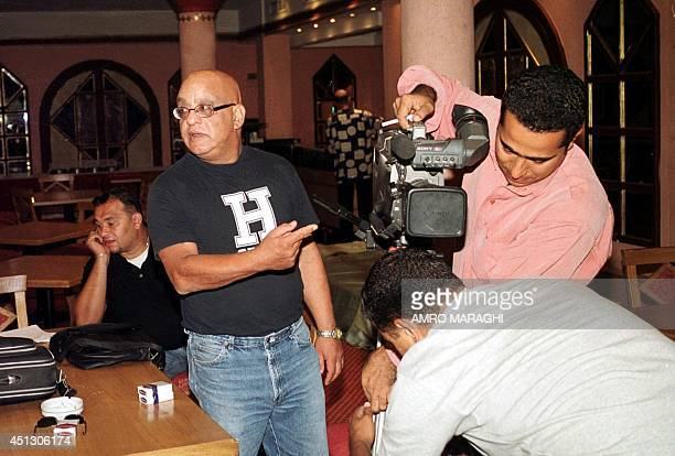 Egyptian director Khairy Beshara instructs his crew during the shooting of the first scenes of his TV series Masaalet Mabdaa at a hotel in Giza south...