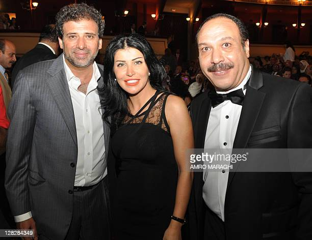 Egyptian director Khaled Yussef Syrian actress Jumana Murad and Egyptian actor Khaled Saleh attend the opening ceremony of the 27th annual Alexandria...