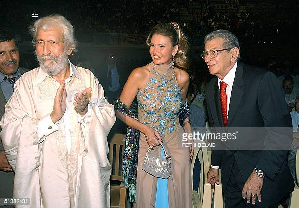 Egyptian director Youssef Shahine poses with Egyptian actress Yousra and Tunisian Tahar Cheriaa at the opening of the Carthage film festival 01...