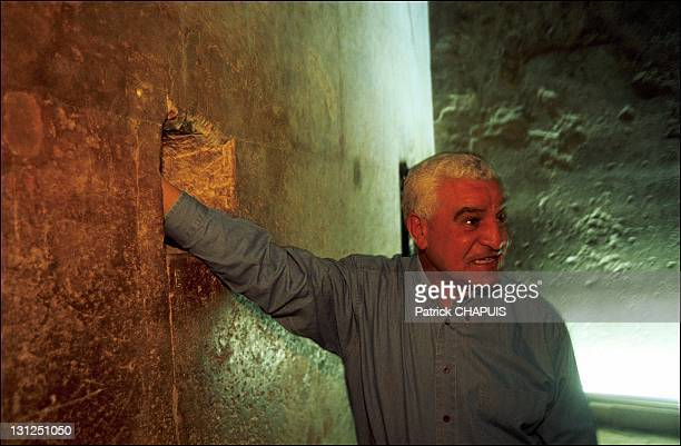 Egyptian Egyptologist Zahi Hawass Secretary General of the Supreme Council of Antiquities in the Queen's chamber showing a vent through which the...