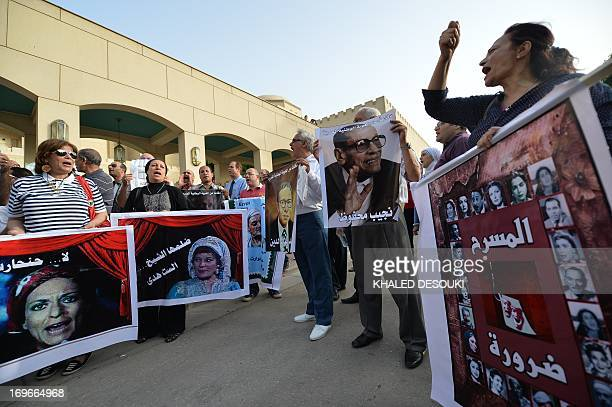 Egyptian employees of the Cairo Opera House and opponents of their Islamist President Mohamed Morsi hold a portrait of the late Nobel Prize for...
