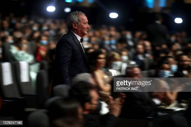 Egyptian entrepreneur Samih Sawiris walks the aisle of the amphitheatre, at the opening ceremony of the 4th edition of El Gouna Film Festival, in the...