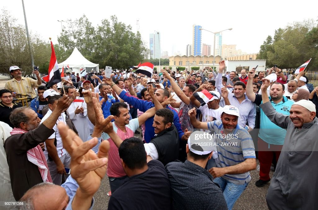 Egyptian expatriates living in Kuwait celebrate as they