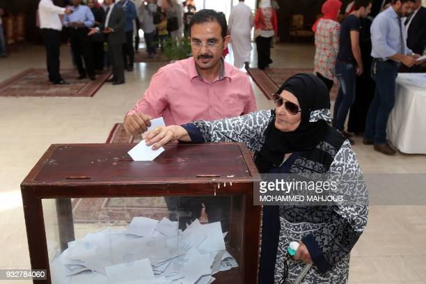 Egyptian expatriates living in Oman cast their ballot for the Egyptian presidential elections at the Egyptian embassy in Muscat on March 16 2018...