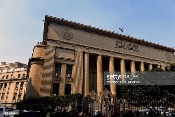 Egyptian family members of victims of the Port Said massacre react outside the Court of Cassation following the court's ruling in the case in Cairo...