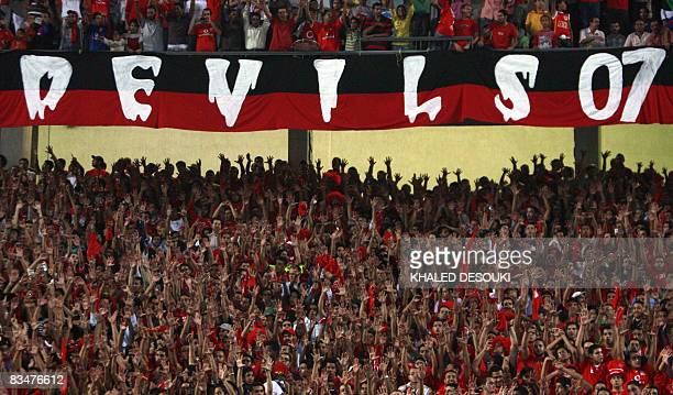 Egyptian fans of AlAhly club cheer for their team before their second leg semifinal match against Nigerian team Enyimba in the African Football...