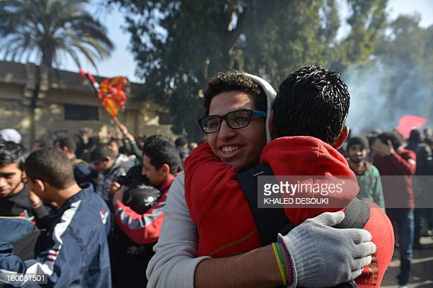 Egyptian fans of AlAhly football club celebrate outside the club's headquarters in Cairo on January 26 2013 after a court sentenced 21 people to...