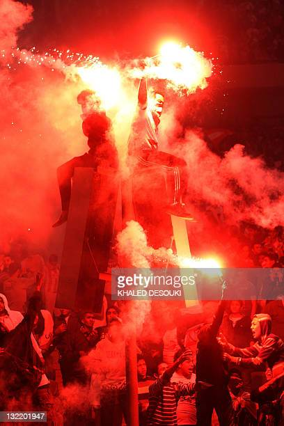 Egyptian fans of Zamalek club celebrate during a friendly football match against Atletico Madrid in Cairo on November 10 2011 to mark the 100th...