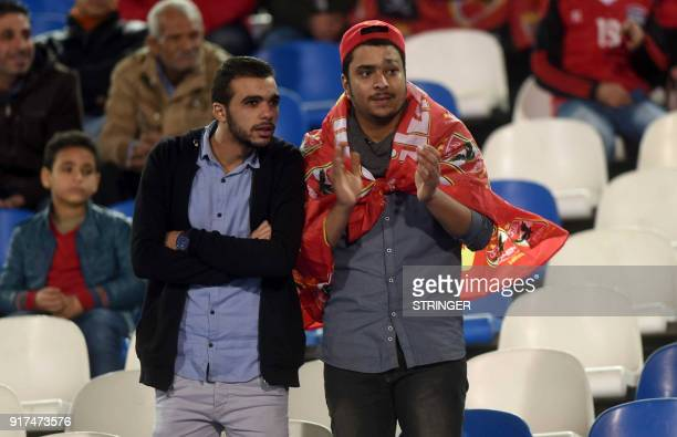 Egyptian fans watch a football match between alAlhy and elMokawloon at a Cairo stadium on February 12 2018 Limited numbers of football fans are to be...