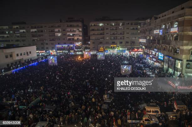Egyptian fans watch on a giant screen the Africa Cup of Nations football match between Egypt and Cameroon on February 5 in the capital Cairo during...