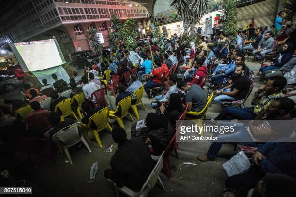 Egyptian fanse gather at a sports cafe to watch the CAF Champions League final football match between AlAhly vs Wydad Casablanca in Cairo's 6th of...