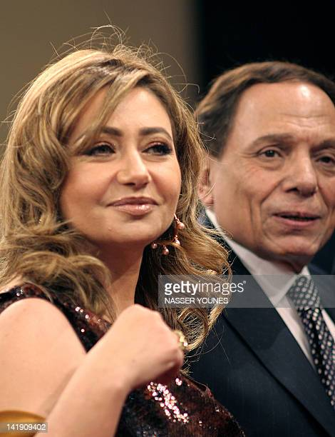 Egyptian film star Leila Elwi arrives with fellow top comedian Adel Imam at the opening ceremony of Dubai's International Film Festival 11 December...