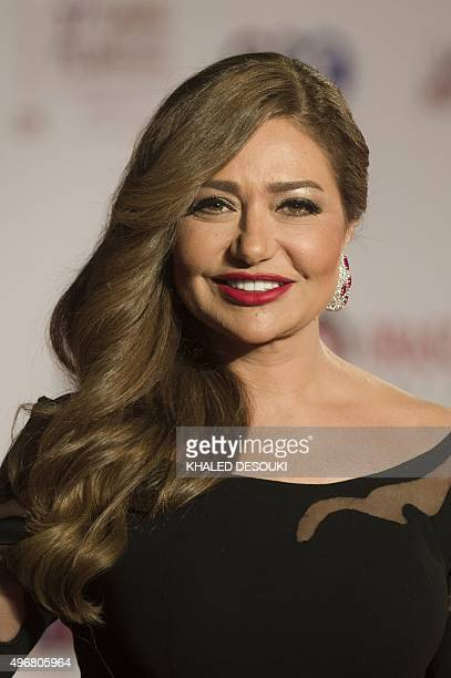 Egyptian film star Leila Elwi poses for photographers at the opening ceremony of the 37th Cairo International Film Festival at the Cairo opera house...