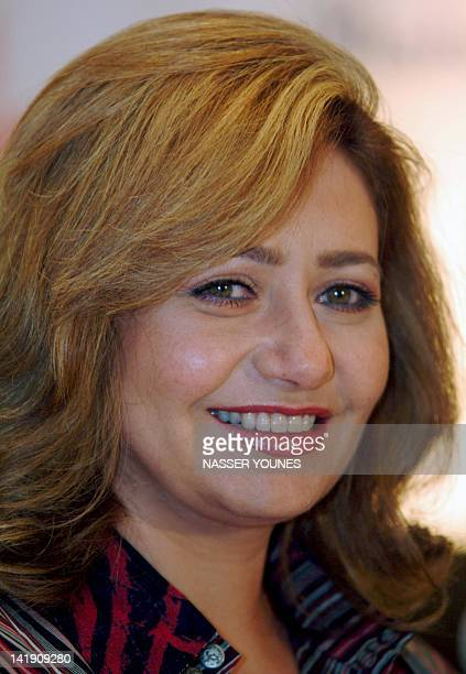 Egyptian film star Leila Elwi smiles during a press conference on the sidelines of the Dubai International Film Festival 09 December 2004 Alwi's...