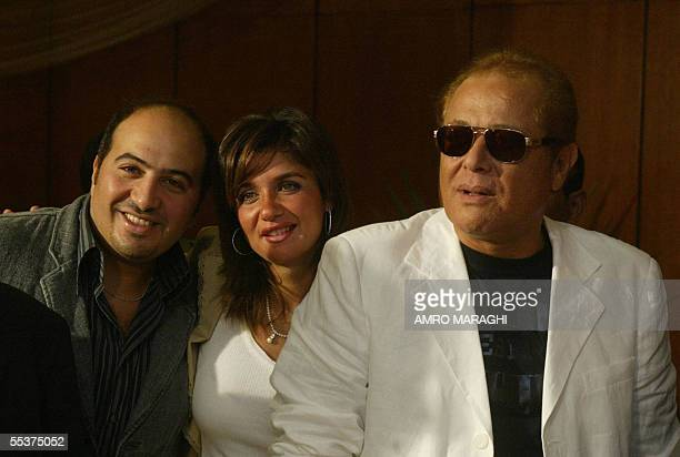 Egyptian film star Mahmud Abdel Aziz poses with Ghada Adel and her husband director Magdi alHawari at the opening of the 27th Alexandria...