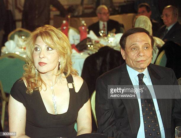 Egyptian film stars Adel Imam and Nadia elGindi attend the 25th Egyptian Cinema Oscar awards ceremony in Cairo late 20 February 2004 AFP PHOTO/Amro...