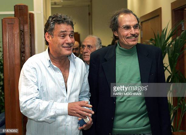 Egyptian film stars Faruq alFishawi and Ezzat alAlayli arrive 05 December 2004 at Dubai airport to attend the Dubai International Film Festival The...