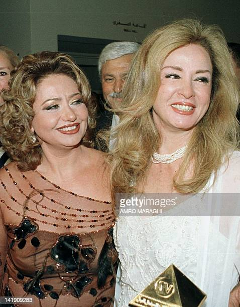 Egyptian films stars Leila Elwi and Naglaa Fathi pose for photographers during the opening ceremony of Cairo's 27th International Film Festival in...