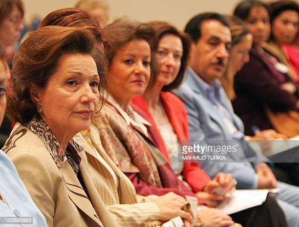 Egyptian First Lady Suzanne Mubarak sits in the front road among other attendants during a parallel interactive session on human trafficking during...