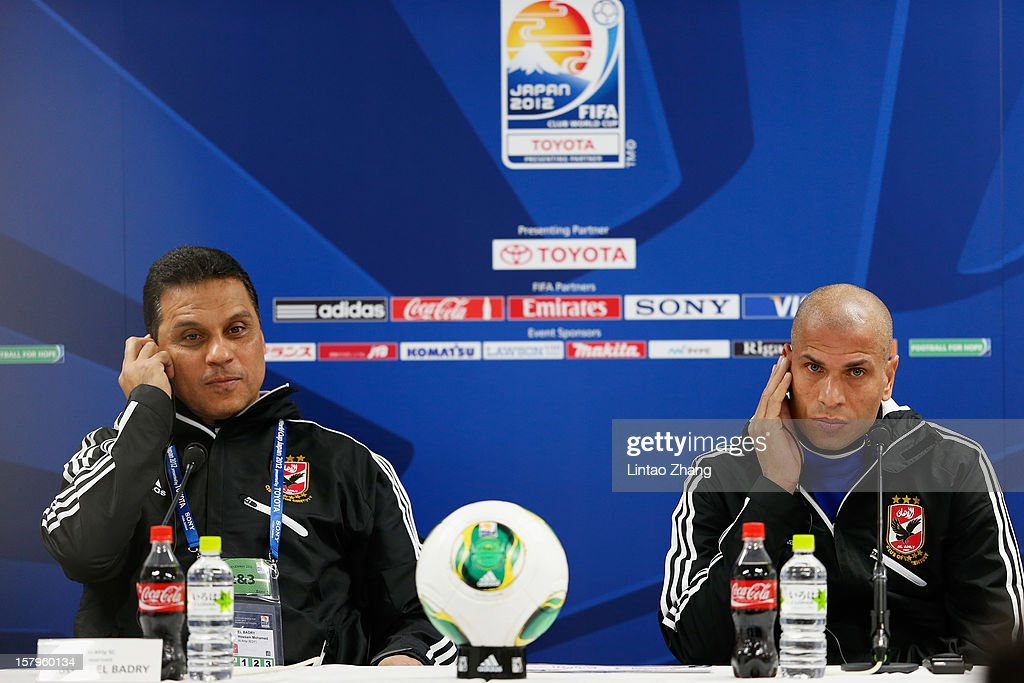 Egyptian football club team Al Ahly head coach Hossam El-Badry (L) and defender Wael Gomaa (R) listen to questions during the press conference at Toyota Stadium on December 8, 2012 in Toyota, Japan.