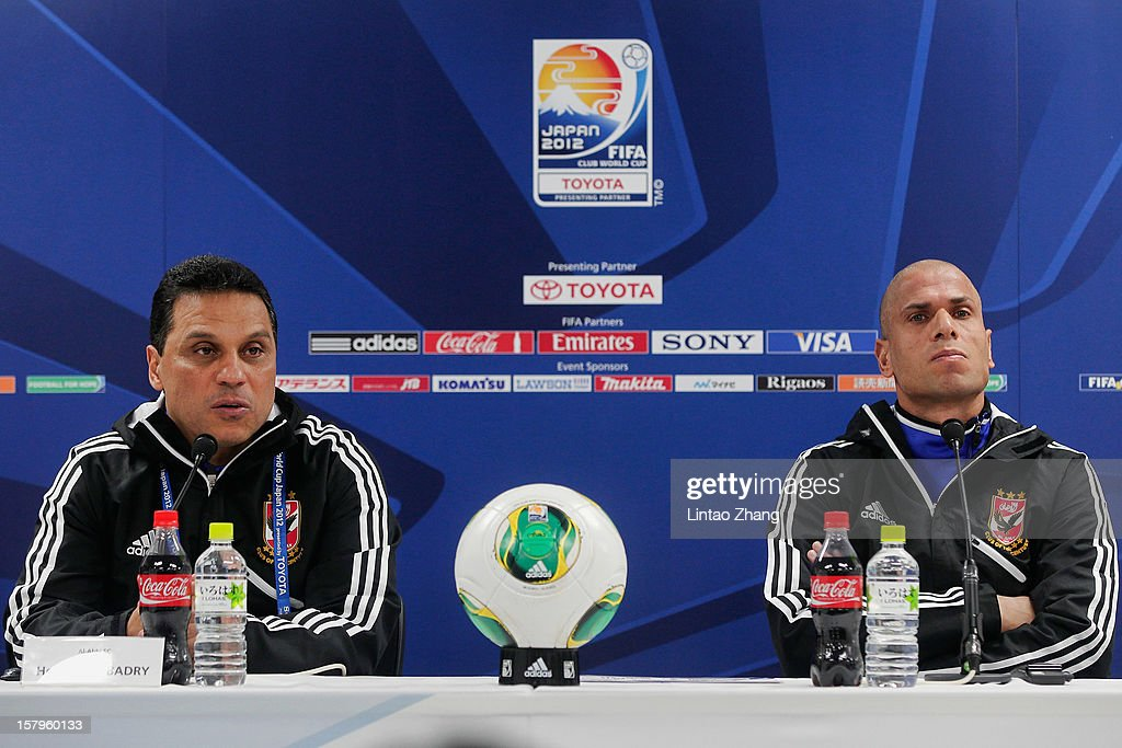 Egyptian football club team Al Ahly head coach Hossam El-Badry answers a question with defender Wael Gomaa (R) during press conference at Toyota Stadium on December 8, 2012 in Toyota, Japan.