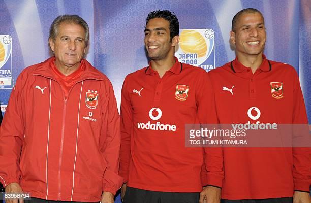 Egyptian football club team Al Ahly's Portugese head coach Manuel Jose captain Shady Mohamed and defender Wael Gomaa pose for a photo after their...