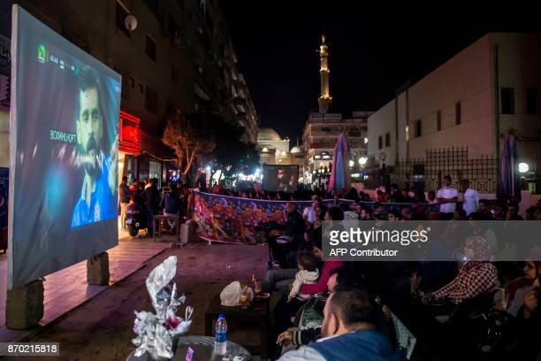 Egyptian football fans watch from the outskirts of Cairo the CAF Champions League final football match between Egypt's AlAhly and Morocco's Wydad...
