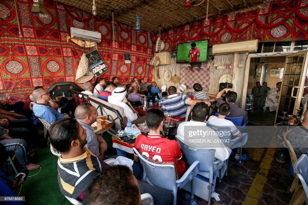 TOPSHOT - Egyptian football supporters and expatriates in