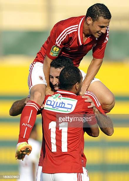 Egyptian Footballer Mohamed Abou Trika of alAhly celebrates with his teammates after scoring a goal during their CAF Champions League Group A...