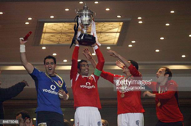 Egyptian footballers of AlAhly club Shady Mohamed goalkeeper Amir Abdelhamid Ahmad ElSayed and Osama Hosny celebrate the African Super Cup after...